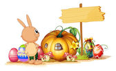 A rabbit, easter eggs, a pumpkin and an empty signboard — Stock Vector