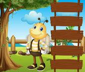 A honeybee beside a blank template — Stock Vector
