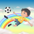 A boy playing soccer - Stock Vector