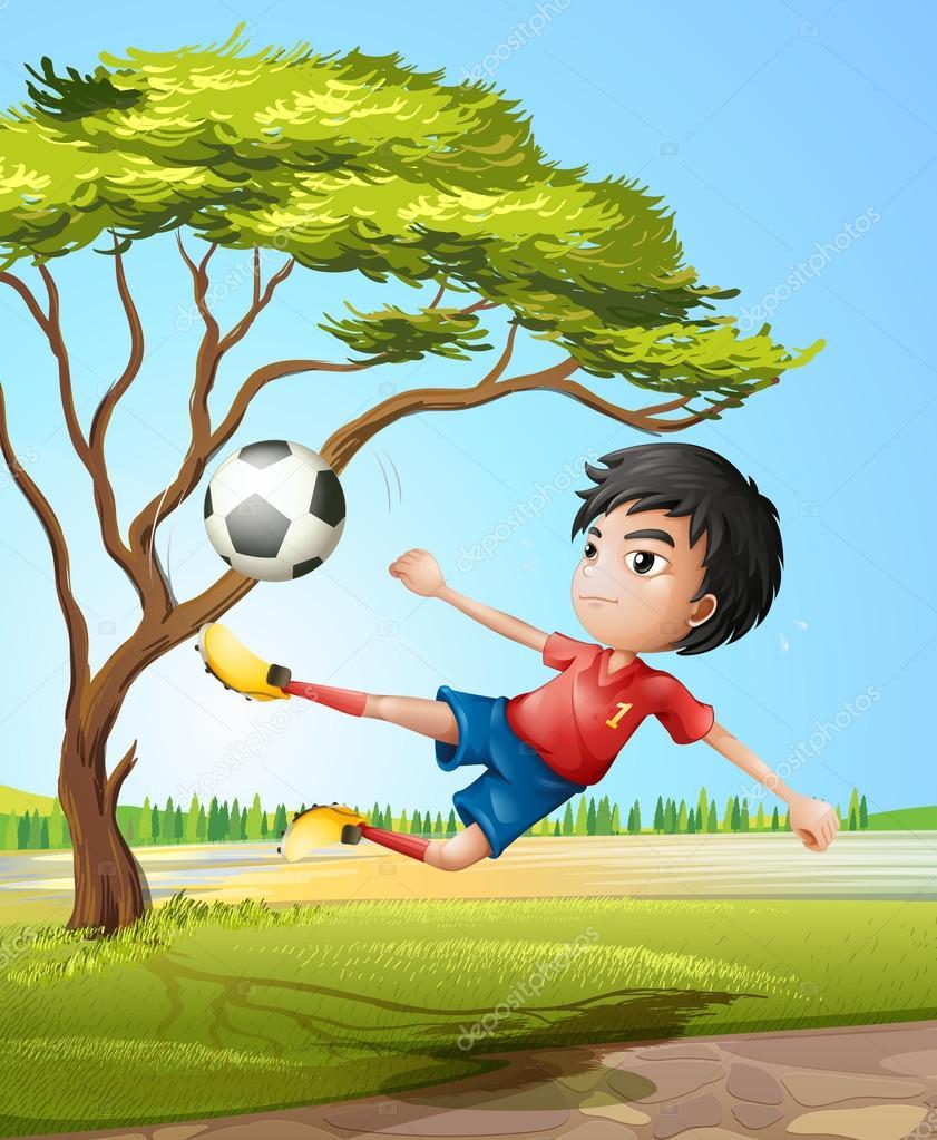 un niño jugando fútbol en el camino — Vector stock © interactimages #
