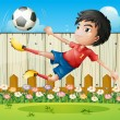 Stock Vector: A boy playing soccer inside the fence