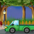 A green car at the street — Stock Vector