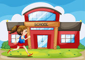 A girl in front of the school building — Stock Vector