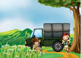 A girl and a boy beside the green truck — Stock Vector
