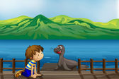 A boy and a sea lion — Stock Vector