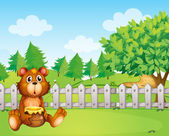 A bear holding a honey at the backyard — Stock Vector
