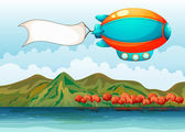 The empty banner carried by the colorful airship — Stock Vector