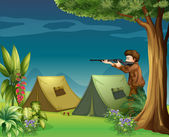 A hunter in a campsite — Stock Vector