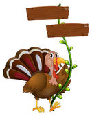 A turkey with a wooden signboard in a vine plant — Stock Vector