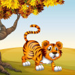 Royalty-Free Stock Vector Image: A tiger in a jumping position near the big tree