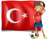 A soccer player in front of a Turkish flag — Stock Vector