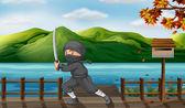 A gray ninja with a sharp sword near the wooden mailbox — Stock Vector