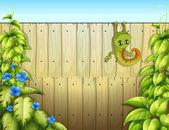 Eine eidechse am zaun — Stockvektor