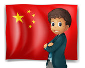 A young boy in front of a Chinese flag — Stock Vector