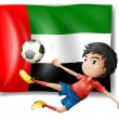 A boy playing soccer in front of the UAE flag - Stock Vector