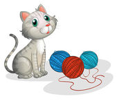 The gray cat with toys — Stock Vector