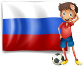 A football player beside the flag of Russia — Stock Vector