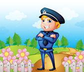 A policeman standing in the garden — Stock Vector