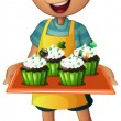 Royalty-Free Stock Vector Image: A young boy holding a tray with cupcakes