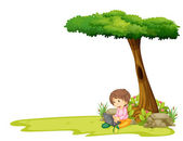 A boy with a laptop under a tree — Stock Vector