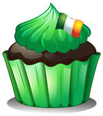 A green cupcake with the flag of Ireland — Stock Vector