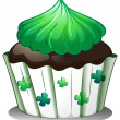 A chocolate cupcake with green toppings - Stock Vector