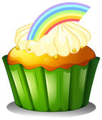 A cupcake with rainbow — Stock Vector