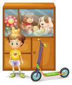 A young boy with his scooter and his toys in a cabinet — Stock Vector
