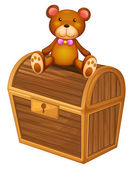 A bear at the top of a treasure chest — Stock Vector