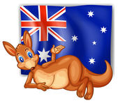 A kangaroo in front of the Australian flag — Stock Vector