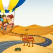 The hot air balloon with kids at the desert - Stock Vector