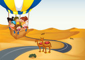 The hot air balloon with kids at the desert — Stock Vector