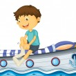 A boy sitting in the boat fixing his sock — Stock Vector