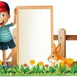 A boy holding a framed empty banner with a rabbit — Stock Vector