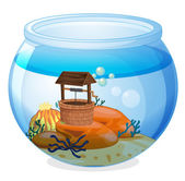 A wishing well inside the aquarium — Stock Vector