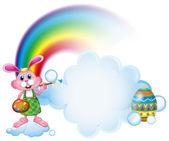 A bunny painting near the rainbow — Stock Vector
