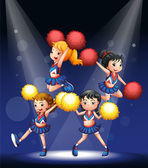 A cheering squad with red and yellow pompoms — Stock Vector