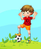 A young football player — Stock Vector