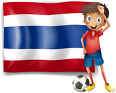 A football player in front of the Thailand flag — Stock Vector