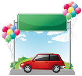 A tinted red car near the empty green board — Stock Vector