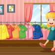 A girl beside the hanging clothes inside the house - Stock Vector