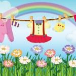 A baby girl's clothes — Stock Vector