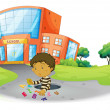 A boy playing in front of the school building - Stok Vektör