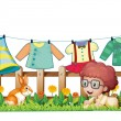 A boy and a bunny in a garden with hanging clothes — Stock Vector