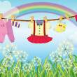 Kids clothes hanging near the grass — Stock Vector