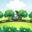 A boy riding in his bike at the street — Stock Vector