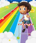 A little boy near the stripe hurdle — Stock Vector
