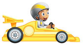 A boy riding in a yellow racing car — Stock Vector