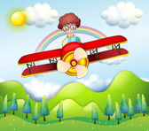 A boy riding in a red plane — Stock Vector
