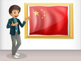 The flag of China presented by a man — Stock Vector